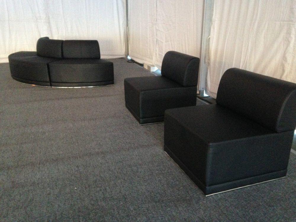 Black leather furniture with pewter carpet